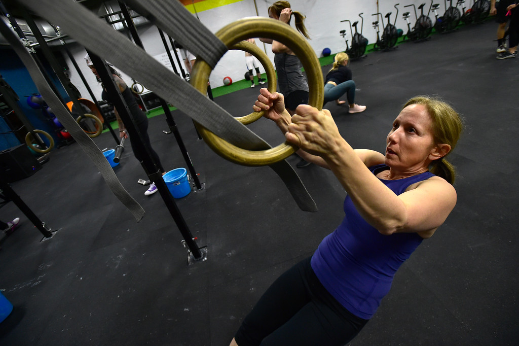 . BOULDER, CO. NOVEMBER 14, 2018 Donna Manizza works the Ring Rows BLDR30 workout at Boulder Athletics in Boulder on Wednesday.  For more photos go to dailycamera.com  (Photo by Paul Aiken/Staff Photographer)