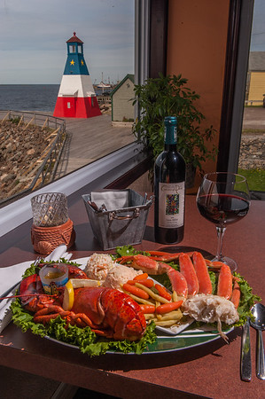 A seafood dinner of lobster and crab is a feature of the Harbour Restaurant  & Bar in Cheticamp on the Cabot Trail