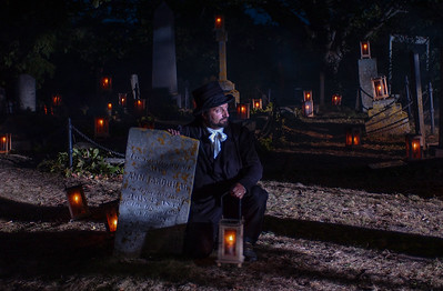 Alain Melanson, an employee at the Fort Anne National Historic Site in the town of Annapolis Royal , conducts candelight graveyard tours several times a week.
