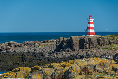 The Western Lighthouse sits on the basalt rock  shoreline of Brier Island at the end of Digby Neck in southwest Nova Scotia