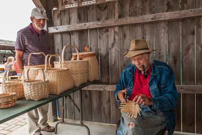 Eighty-year-old basket maker Murray Moores demonstrates his skill at the weekly farmers' market in the Acadian village of Belliveau's Cove in Clare.