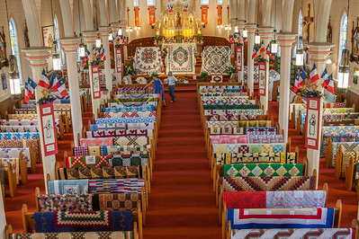 The pews inside Eglise Sacre Coure Catholic church in Saulnierville are covered with handmade quilts during the quilt show, part of the annual Festival Acadien de Clare