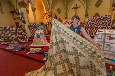An quilt exhibit in the Acadian church at Middle West Pubnico