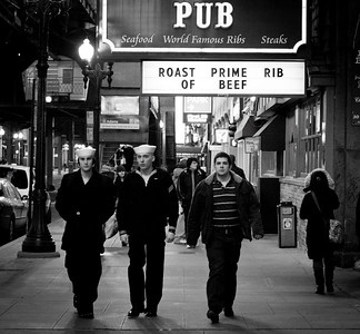 Sailors walk past Miller's Pub in Chicago, Illinois on February 19, 2011.  (Jay Grabiec)