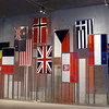 Visitors center museum at Omaha Beach military cemetery. Flags of the Allied forces.