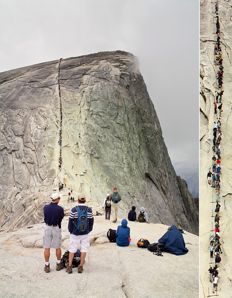Half Dome cables on June 13, 2009 at 12:20 am.   This picture was taken before a hailstorm and rain hit. Note the large number of people going up on the cables.  Check out the crazy guy who is walking outside the cable line with one only hand holding the cable; this part is still quite steep (it is best to look at the larger size version, just click on the photo).  We went up about 10 minutes after this photo was taken.