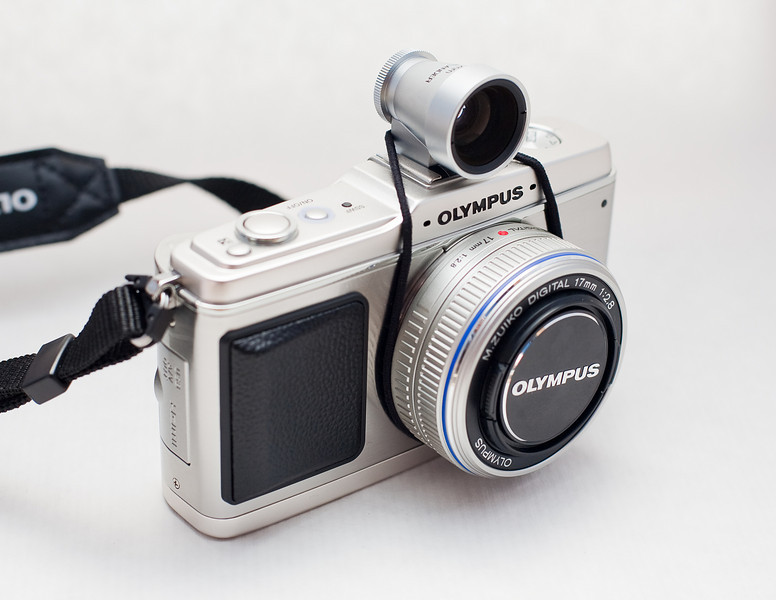 "<b>Olympus EP-1 tips, tricks and wishlist post:</b>  <b>Customization:</b>  1. Use SAF/MF mode, and move AF to the AEL/AF button, (same as the famous CF4 in Canon SLRs).  Presto, you have AF-on demand.  2. Remap the AF selection button (left dial press) to the metering mode selection.  If you do the previous customization, the AF mode selection on-the-fly is useless, so metering mode selection makes a lot of sense.     3. This is a tricky point.  As far as I know, there is no quick way to switch between WideAF and center AF selection, so here is the workaround.  Remap the Fn. button to Face-Detection AF, then set the AF area to the center point.   Face detection is by default WIdeArea, so now when you switch between the FaceDetection On and OFF, you are effectively switching between Center Point and WideArea.    Another way to set the Fn button is for DOF preview.  4. Set the two dial functions to the Canon-style controls: vertical dial controlling ProgramShift/Aperture/ShutterSpeed in P/A/S modes and the round dial controlling the exposure compensation.   <b>Wishlist for Olympus for a firmware update:</b>  1. Make the 10x zoom on focusing apply only to the center 60% o the image, it is a very useful to see the periphery of the image as you focus in the center.  It is trivial to implement.  2. Give the ability to remap the +/- button to the DOF preview.  With the exposure compensation remapped to the dial, this button is useless, so, give us the ability to use it.   3.  Make half-shutter press return the LCD image to normal magnification in all modes.  MF lens users will appreciate it.  4. If the user activates MF, the lens should open up the the max aperture to help with precise focusing.  Even manual cameras can do that with the ""jumping"" aperture mechanisms."