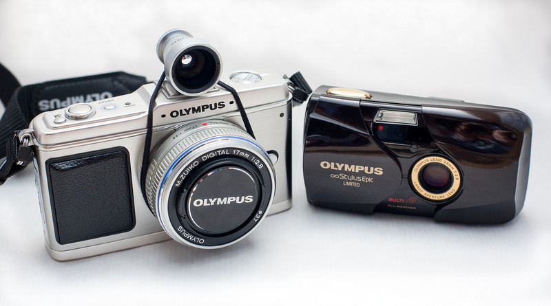 I have a long-standing relationship with Olympus compact cameras.  (Incidentally, both of these camera have an equivalent of 35/f2.8 lens).