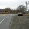 Route 61 northbound now curves to the right and detours around the original, damaged road for a mile or two until arriving at the outskirts of Centralia.