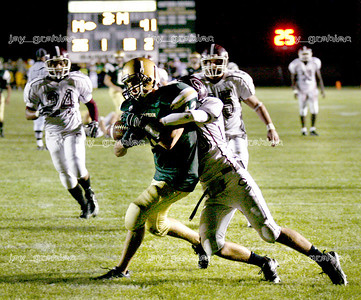 Senior wide receiver Cody Ashwort pushes though to the end zone for a touch down with just over two minutes of regulation in the first half of the Mattoon High School homecoming football game against Champaign Central High School on Friday, October 3, 2008. (Jay Grabiec/Staff Photographer)