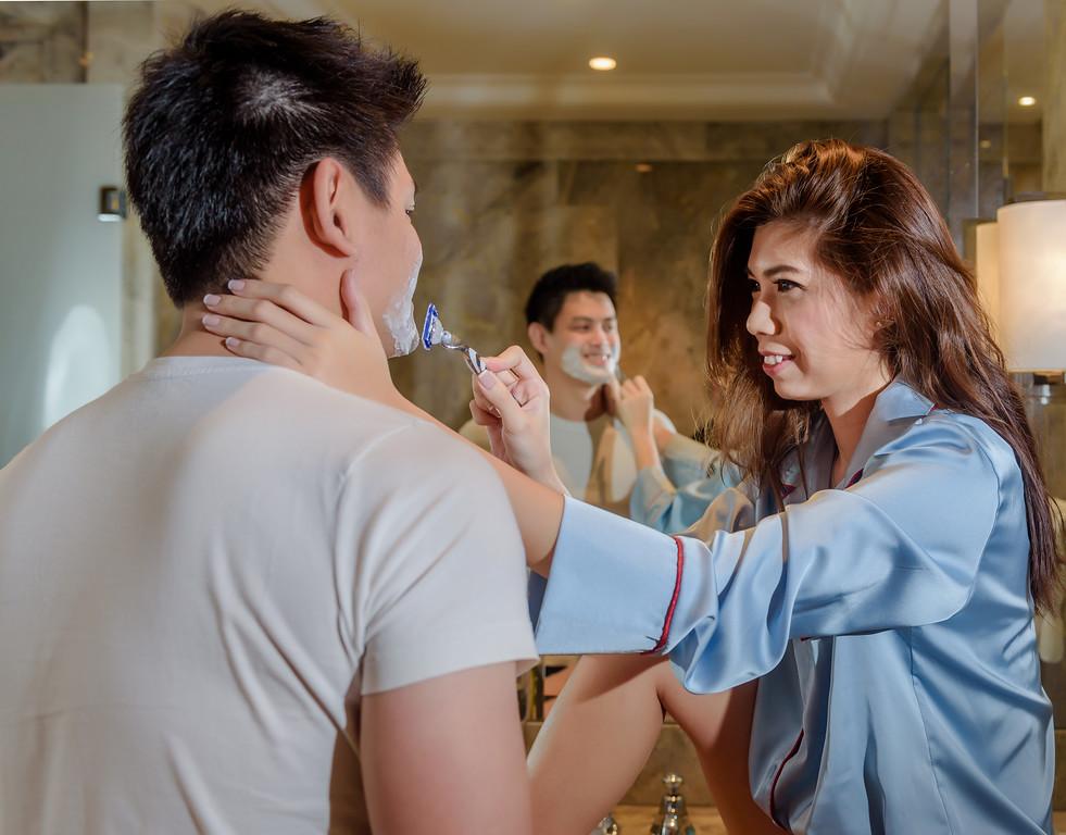 Bride doing shaving for groom