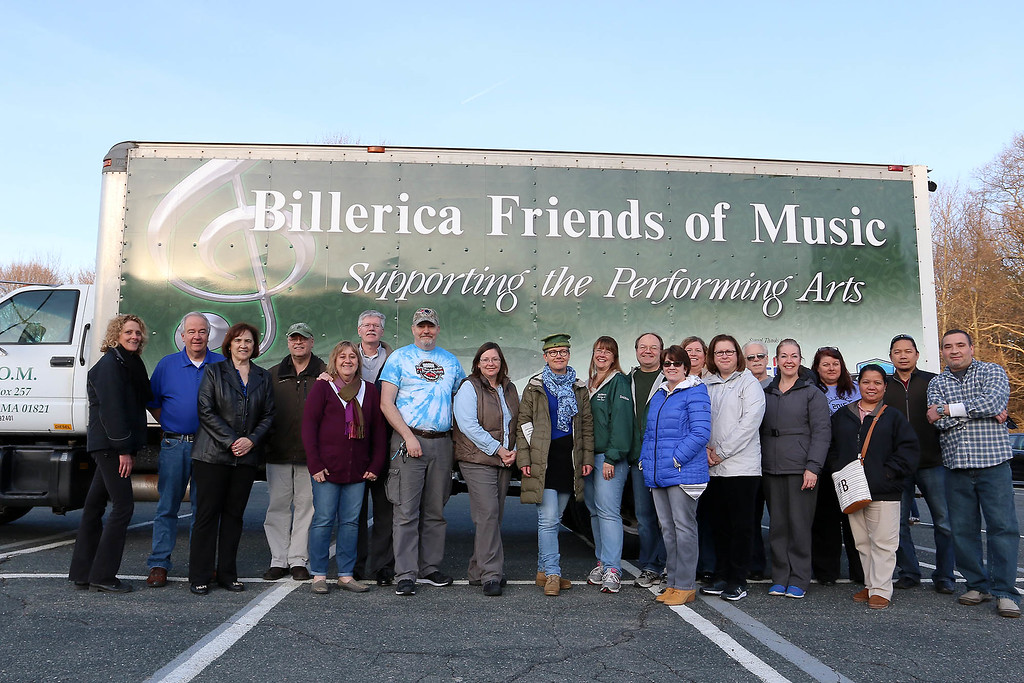 . Many of the vounteers along with Band Director Elaine Winchell, on left, pose in front of their truck they bought in 2001. SUN/JOHN LOVE