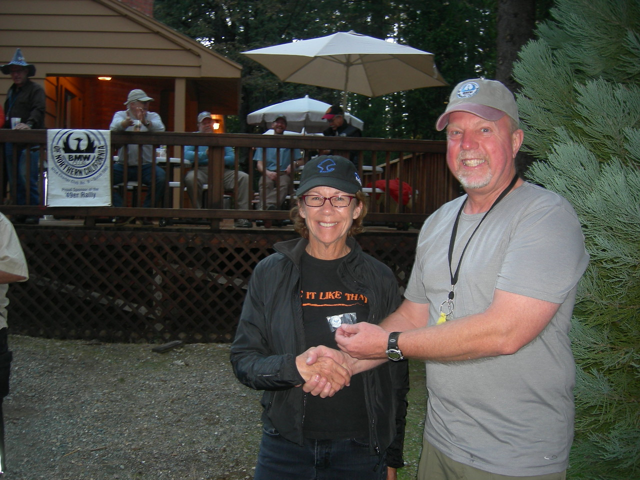 The lovely Pat Potter receives her 25-year membership pin from VP Peter Oxenbol.
