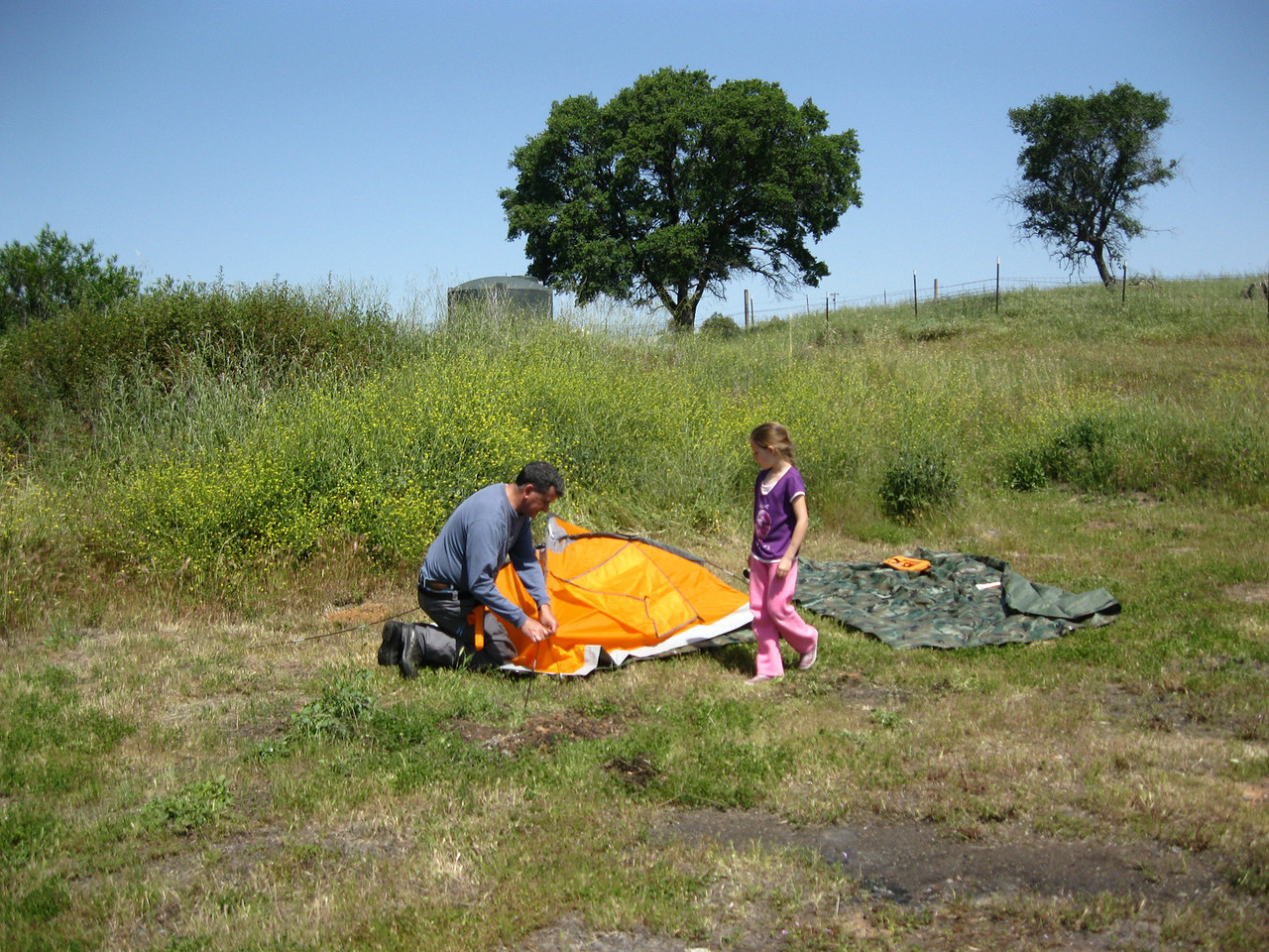 The lovely Stella helps Javier Sanchez set up his tent. Stella speaks perfect Spanish.