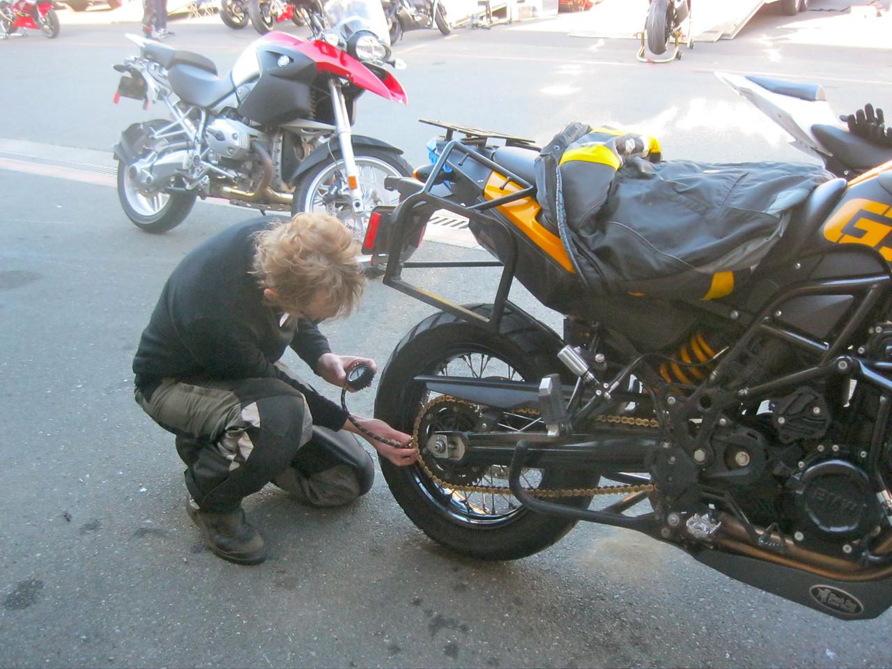 Cliff Dunn setting his tire pressure.