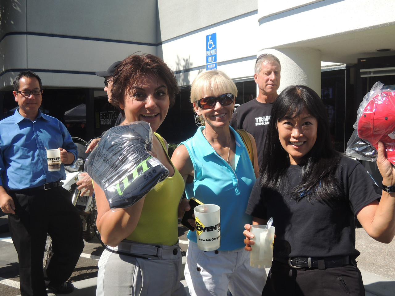 Slow Race winners Bita Malek and Mini display their prizes as the lovely Melanie joins in.