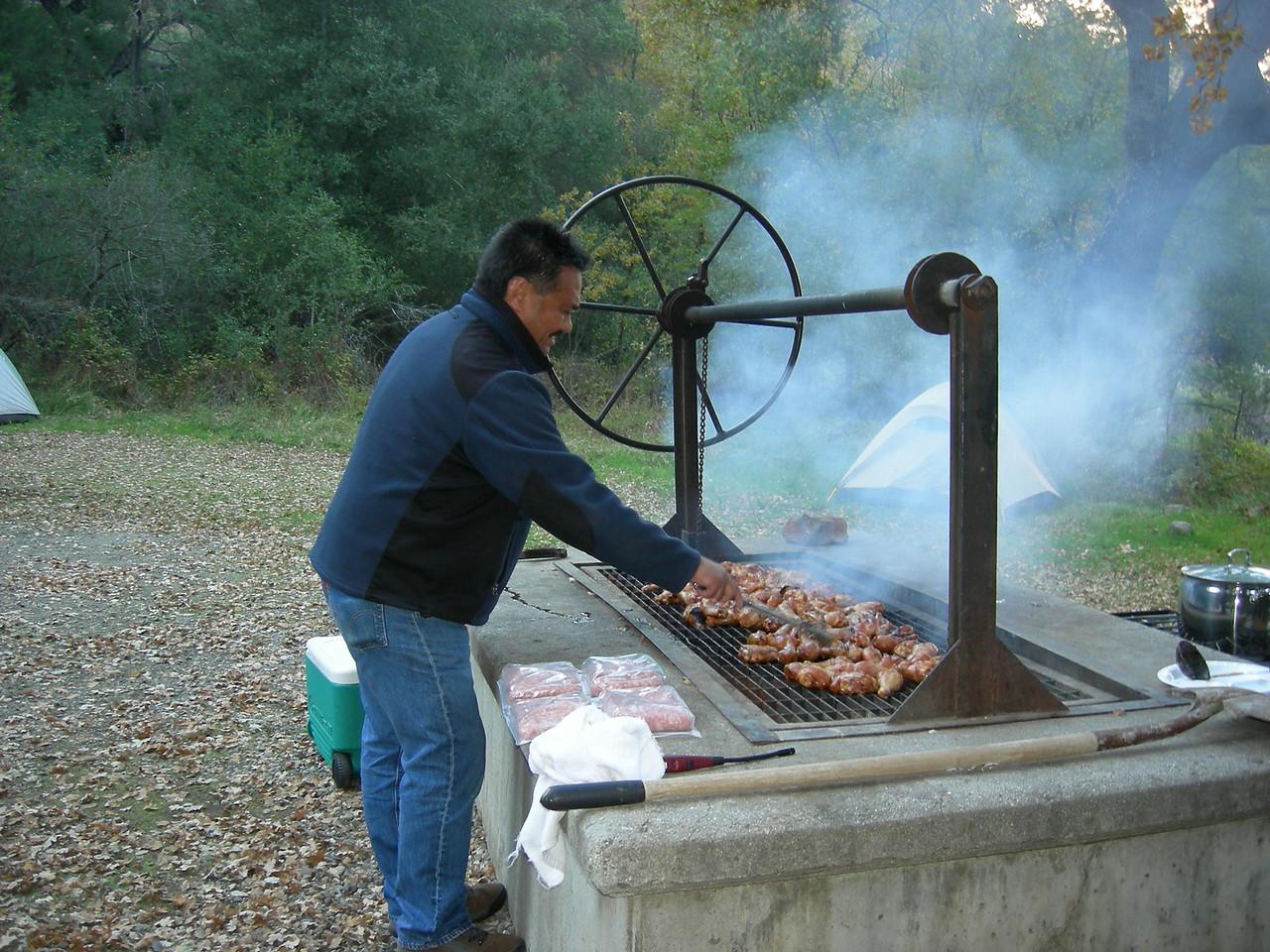 Bob Empasis (P'Bob) cooking for the group.