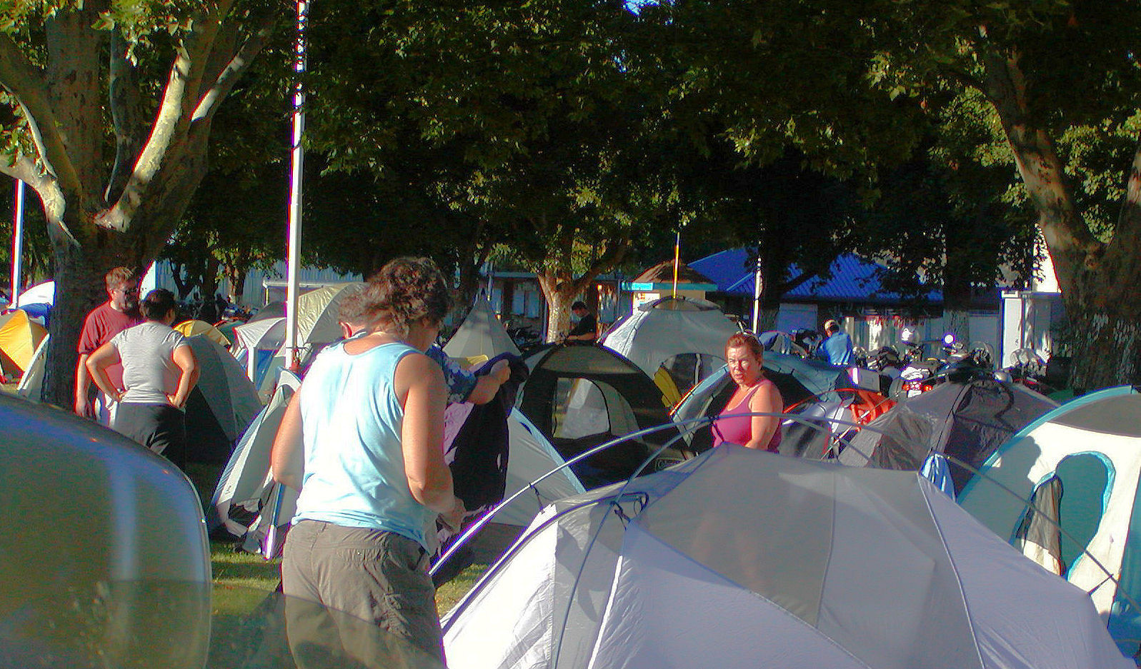 People, tents, trees