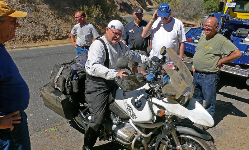 The owner, who suffered not a scratch from landing in the bushes, checks out the bike. Broken screen, bent bags, and wounded pride (Photo:Tandy Bozeman)
