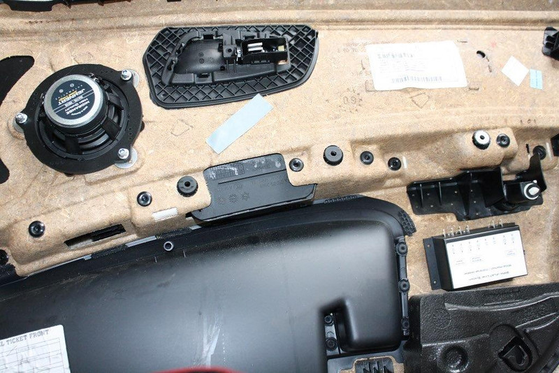 "Rear view of door panel with aftermarket speaker and speaker adapter brackets   from  <a href=""http://www.car-speaker-adapters.com/items.php?id=SAK076""> Car-Speaker-Adapters.com</a>   mounted"