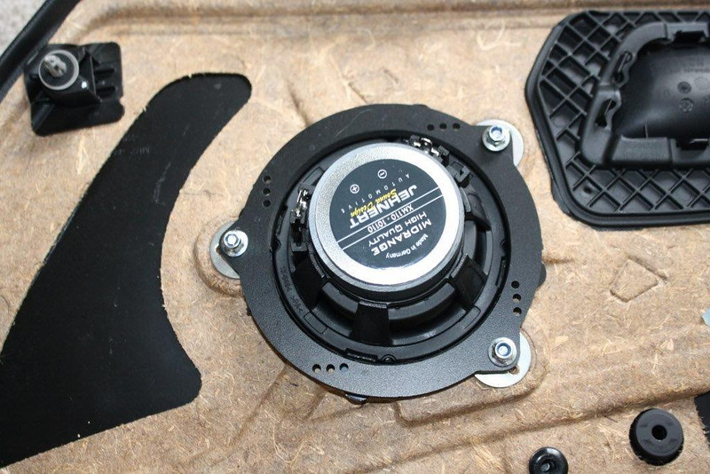 """Rear view of door panel with aftermarket speaker and speaker adapter brackets   from  <a href=""""http://www.car-speaker-adapters.com/items.php?id=SAK076""""> Car-Speaker-Adapters.com</a>   mounted"""