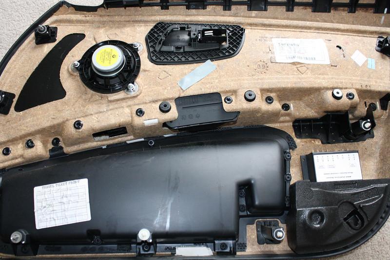 Rear view of door panel with factory speaker still installed