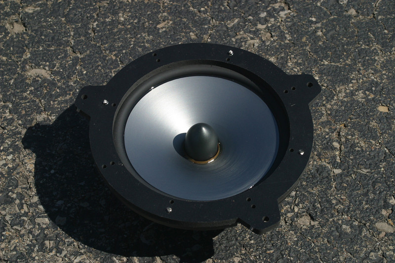 """Front view: Aftermarket speaker mounted to speaker adapter from    <a href=""""http://www.car-speaker-adapters.com/items.php?id=SAK015""""> Car-Speaker-Adapters.com</a>"""