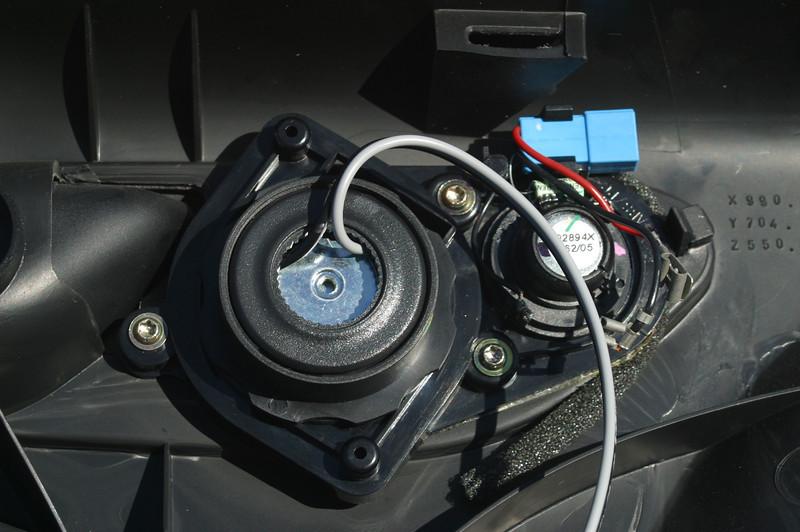 Aftermarket tweeter mounted in place of factory midrange speaker.  Factory tweeter left disconnected.