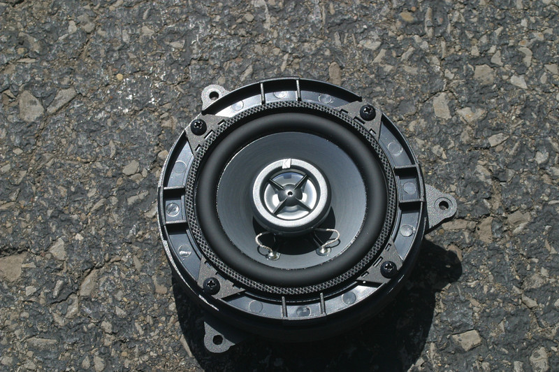 "Front view: <br> Aftermarket speaker mounted to speaker adapter bracket from    <a href=""http://www.car-speaker-adapters.com/items.php?id=SAK110""> Car-Speaker-Adapters.com</a>"