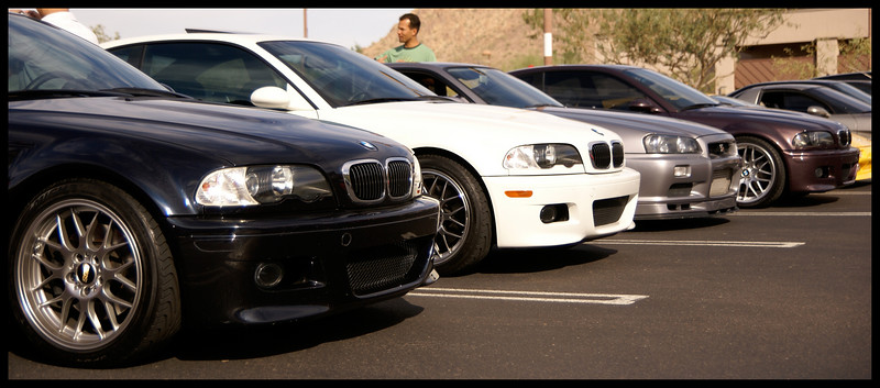 Mike's carbon black M3, an alpine white M3, a Nissan Skyline (right hand drive), and my violet M3.