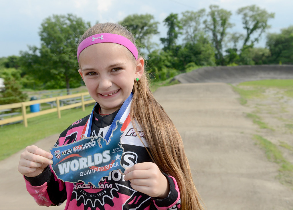 . Tania Barricklo-Daily Freeman                      Seven year old Jenna Miller, daughter of Kelly and Joe Miller of Saugerties, hoiolds up her qualifying medal for the World\'s competition.