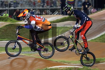 Niek Kimmann (313) of the Netherlands and Connor Fields (11) of the United States race at the UCI BMX Supercross World Cup Round 8 at Rock Hill, S.C., on Saturday, Sept. 14, 2019.