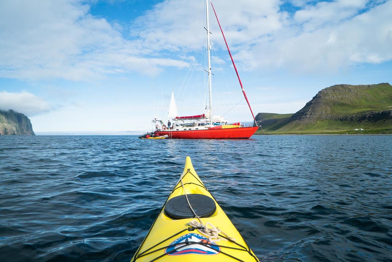 Kayaking in Hornvik. Aurora Arktika anchored.