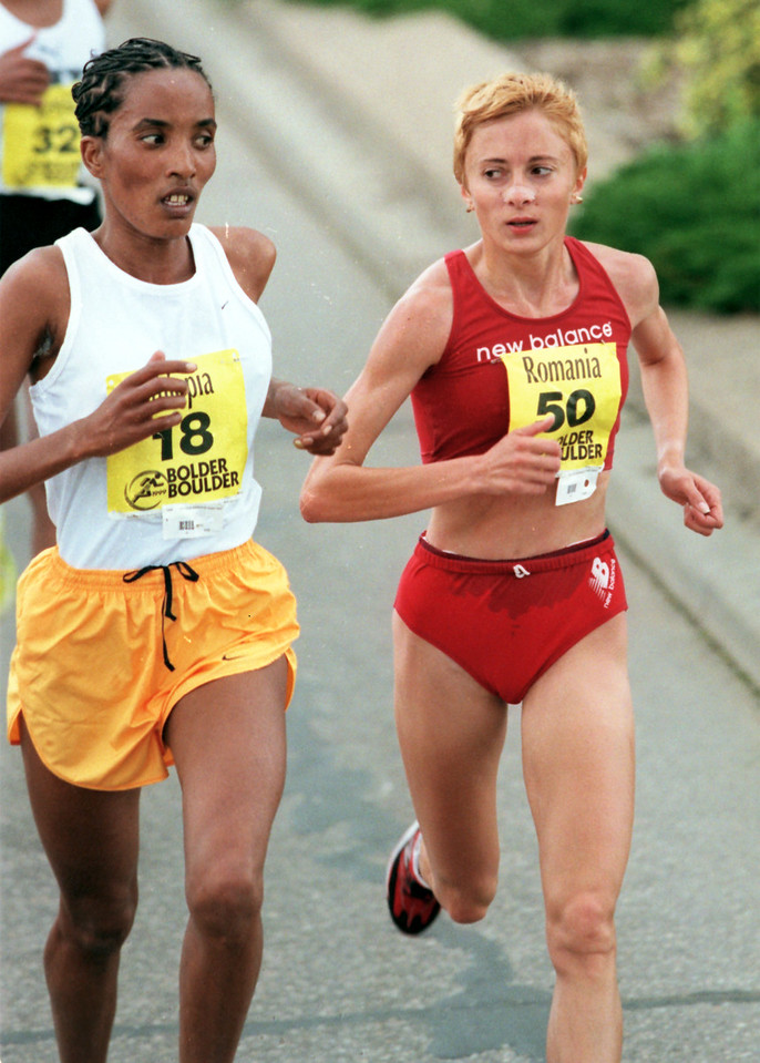 1999 Bolder Boulder Womens Winner Lidia Simon runs down a competitor.