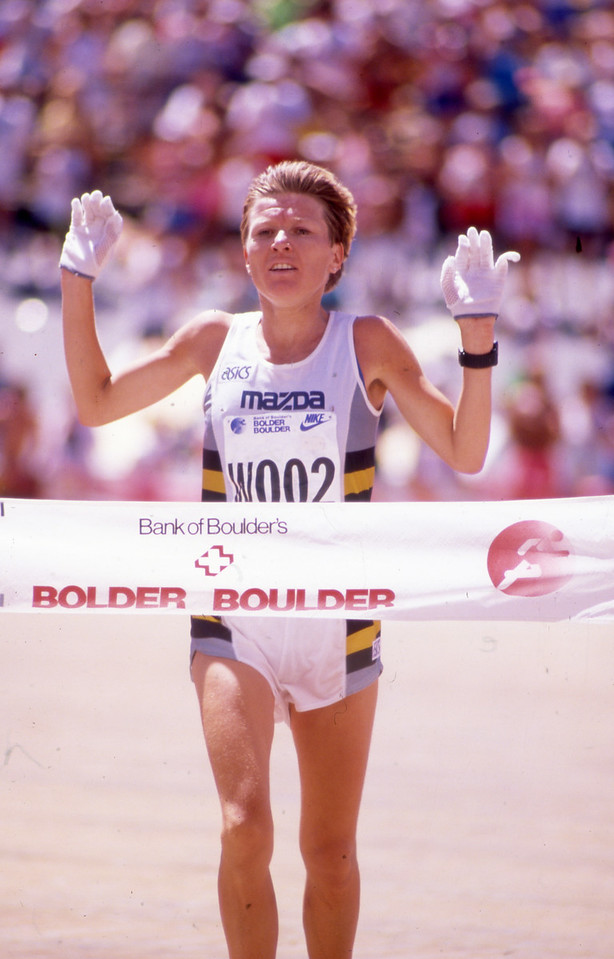 Ingrid Kristiansen Womens winner of the 1989 Bolder Boulder is breaks the finish line in Folsom Field.