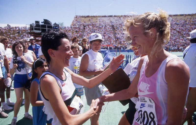 1988 Women Race winner Rosa Mota greets another runner at the finish of the Bolder Boulder.