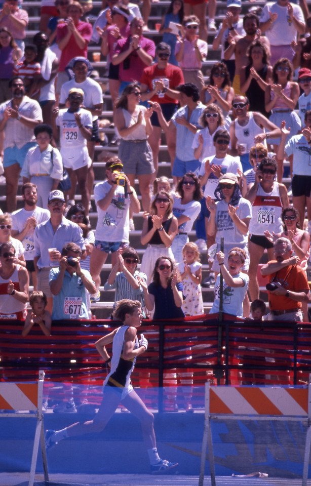 Ingrid Kristiansen Womens winner of the 1989 Bolder Boulder is cheered by the crowd as she enters Folsom Field.