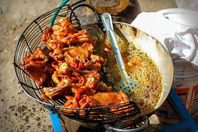 010 Fried chicken on the road to Oruro Bolivia © David Bickerstaff