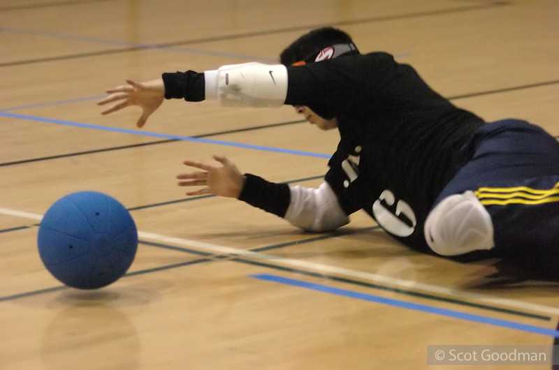 John dives to block. Goalball is a team sport that can be played by visually impaired athletes. It was created in 1946 to help with the rehabilitation of WW2 veterans. In 1980 Goalball became an official Paralympic sport.