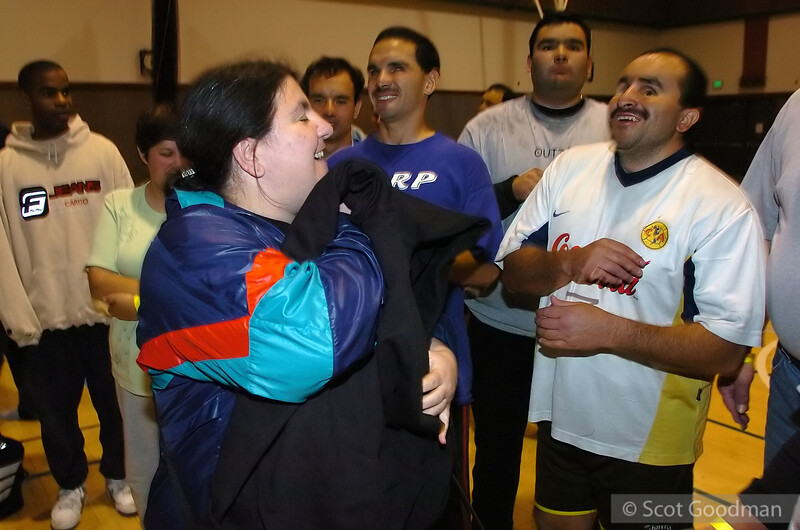 Lucy receives a 10 year sweatshirt - this was Lucy's 10th tournament.