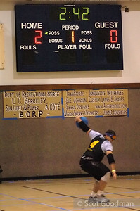 Victor throws. The scoreboard shows it's the first of two 5 minute periods with 2 minutes 42 seconds left in the first half. Jon, the tournament director, uses two five minute periods during regular play for this tournament, other tournaments may have longer halves. Seen below the scoreboard are listed the many sponsors who make this tournament possible.