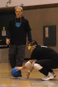Phil (standing), a long time Goalball volunteer, here a line judge, passes the ball to Richard.