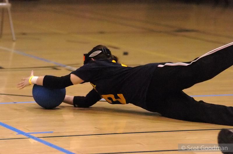 Julie dives on the defense.