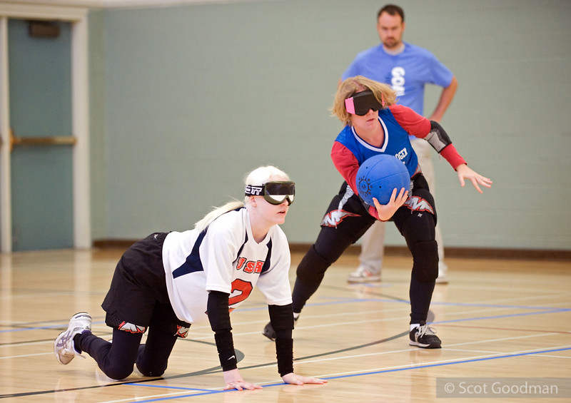 Welcome to BORP's 15th Annual Invitational Goalball Tournament. In this photo, Team Estrogen is about to begin play. A team of three faces another three players at the other end of the court (Team Estrogen's third player is out of frame on the left).