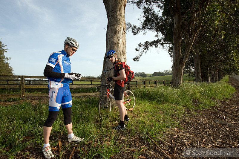 Rest stop, 7:58am. Lakeville Hwy at Old Lakeville Rd 3, Petaluma. Mile 29. Lee gets off his bike for only a few minutes at a time and only after several hours of continuous riding. John Ormsby on the left, there for support.