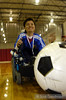 The ball used in power soccer is a soccer ball about the size of a large beach ball (and very expensive - donations to teams and clubs are always welcome. borp.org can help you find teams in need).