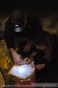 Reviewing routes by headlamp.