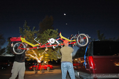 Fred and another volunteer unloading bikes and gear under the twilight of dawn and a rising new moon (that's probably venus directly beneath the brighter larger spot in the sky). The Rev is a showcase for alternative means of human powered transportation.