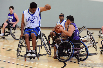 These three frames are out of sequence (until I can figure out how to rearrange them), they show Chuck (23 white) launching his chair into the air to avoid running over a team mate's hands as he falls trying to steal the ball. All five wheels of Chuck's chair will leave the ground.