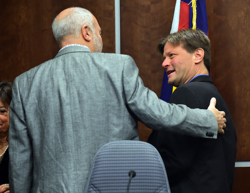 . Newly re-elected Boulder City Council member Sam Weaver, at right, gets a pat on the back by Bob Yates during the swearing in of Boulder City Council members elected or re-elected in the las election during a ceremony in the Boulder City Council Chambers in the city municipal building on Tuesday morning.  For more photos go to dailycamera.com Paul Aiken Staff Photographer Nov 21, 2017